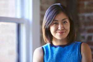 Portrait Of Businesswoman In Office Standing By Window